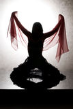 Silhouette of a dancing woman Stock Photography