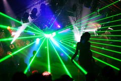 Silhouette of dancing woman between green laser light Royalty Free Stock Photos
