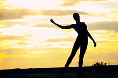 Silhouette of dancing woman over sunset. Yoga Royalty Free Stock Images