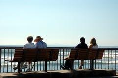 Silhouette de 4 personnes Photographie stock libre de droits