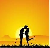 Silhouette de baiser de coucher du soleil Photos libres de droits