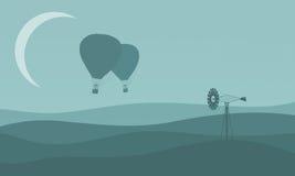 Silhouette de ballon à air avec le moulin à vent Image stock