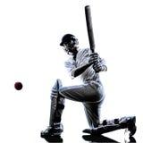 Silhouette de batteur de joueur de cricket Photographie stock libre de droits