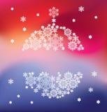 Silhouette de boule accrochante constituée par des flocons de neige Image stock