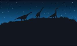Silhouette de brachiosaurus avec l'étoile Images libres de droits