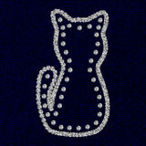 Silhouette de chat avec des diamants de fausses pierres sur la texture bleu-foncé de coton Photo stock