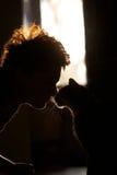Silhouette de chat et de fille, Image libre de droits