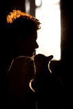 Silhouette de chat et de fille, Images stock