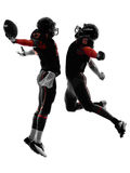 Silhouette de célébration de touchdown de deux joueurs de football américain Photographie stock