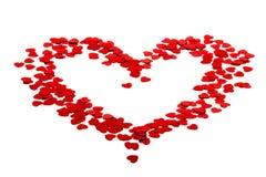Silhouette de coeur faite de confettis rouges Photographie stock libre de droits
