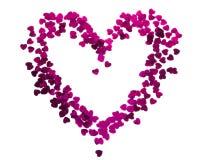 Silhouette de coeur faite de confettis rouges Photo stock