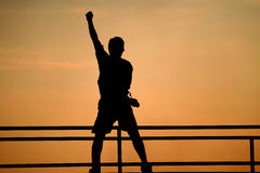 Silhouette de concept de victoire d'homme Images stock
