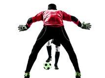 Silhouette de concurrence de gardien de but de footballeur de deux hommes Image libre de droits