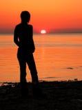 Silhouette de coucher du soleil images stock