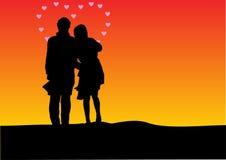 Silhouette de coucher du soleil d'un couple illustration stock