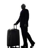 Silhouette de déplacement d'affaires de voyageur supérieur d'homme Image libre de droits