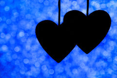 Silhouette de deux coeurs Image stock