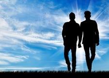 Silhouette de deux homosexuels Photo stock