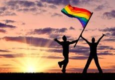 Silhouette de deux homosexuels heureux Photographie stock libre de droits