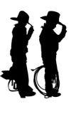 Silhouette de deux jeunes cowboys Photographie stock libre de droits