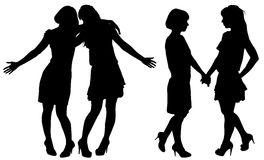 Silhouette de deux jeunes femmes minces Images stock