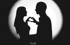Silhouette de deux personnes Photo stock