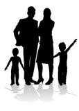 Silhouette de famille Photographie stock libre de droits