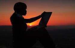 Silhouette de femme d'affaires Photo stock