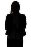 Silhouette de femme debout d'affaires Photographie stock libre de droits