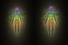 Silhouette de femme et d'homme, aura, chakras, énergie Images libres de droits