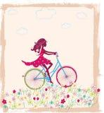 Silhouette de fille sur le vélo Images stock