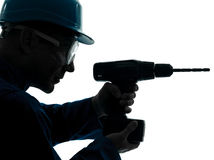 Silhouette de foret de participation de travailleur de la construction d'homme photo libre de droits