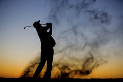 Silhouette de golfeur Photo stock