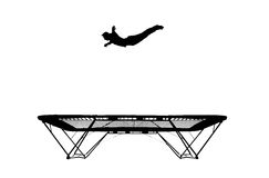 Silhouette de gymnaste sur le tremplin Photographie stock libre de droits