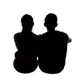 Silhouette de jeunes couples asiatiques Image libre de droits