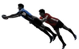 Silhouette de joueurs d'hommes de rugby Image libre de droits