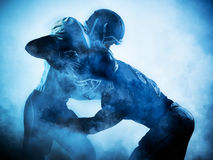 Silhouette de joueurs de football américain photo stock