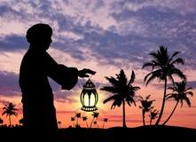 Silhouette de l'homme avec la lampe à disposition photographie stock libre de droits