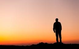 Silhouette de l'homme et de beau ciel Élément de conception Images stock
