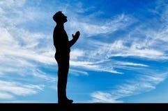 Silhouette de la prière de l'homme Images libres de droits