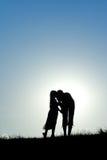 Silhouette de mère et de fille Photo libre de droits