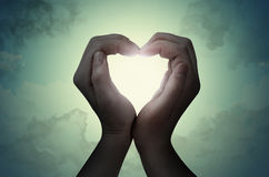 Silhouette de main de forme d'amour Photos libres de droits