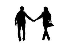 Silhouette de marche de couples Image stock