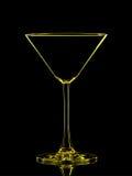 Silhouette de martini jaune sur le fond noir Photos stock
