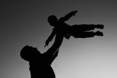 Silhouette de père et de fils Images libres de droits
