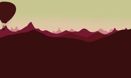 Silhouette de paysage de montagne avec le ballon à air Photos libres de droits