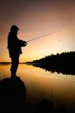 Silhouette de pêcheur Photographie stock libre de droits