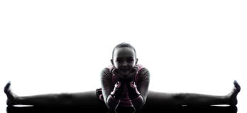 Silhouette de petite fille de gymnastique rythmique Photographie stock