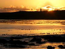 Silhouette de phare Photo stock