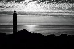 silhouette de phare Photographie stock